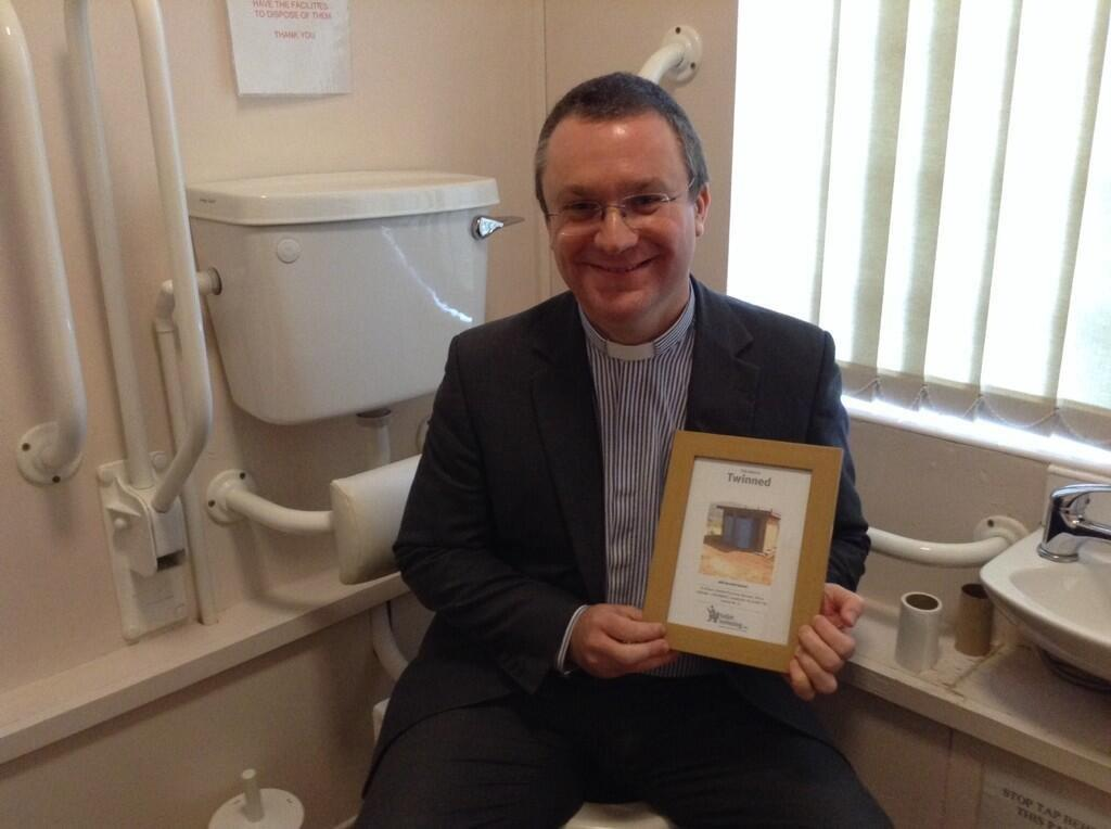 Rev Chris Spittle with one of his church's twinning certificates